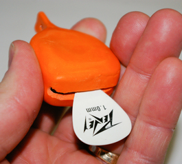 Create a guitar pick grabber