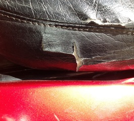 Repair a vinyl motorcycle seat (before)