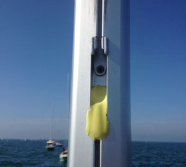 Stop a mainsail from slipping on a racing yacht (before)