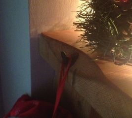 Make a Christmas stocking hook on the fireplace