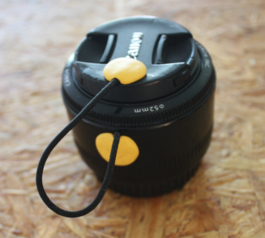 Make a camera lens cap keeper