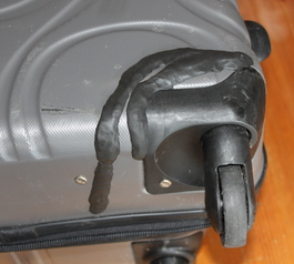 Repair hard-sided luggage on wheels