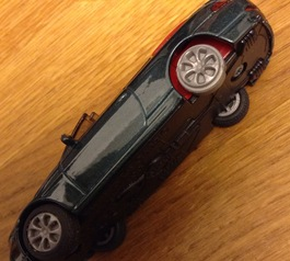 Replace the tyre on a toy car (before)