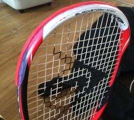 Add a protective bumper to a squash racquet
