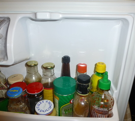 Attach a shelf in a fridge (before)