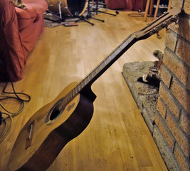 Make an acoustic guitar safer to place on the floor