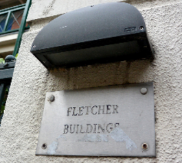 Refresh worn-out lettering on a building name plate (before)