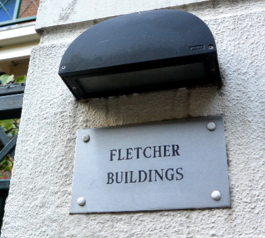 Refresh worn-out lettering on a building name plate (after)