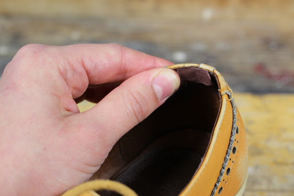 Sugru being applied to inside of shoe