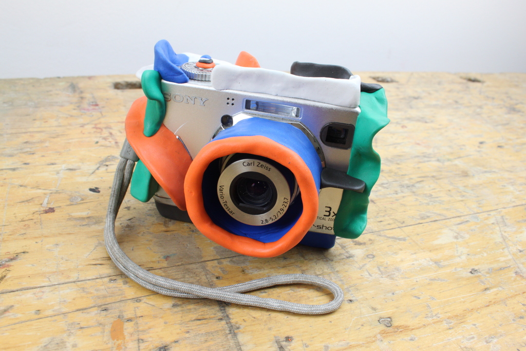Camera on a table with Sugru attached for protection
