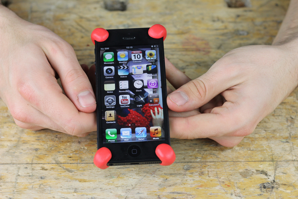 iPhoen with Sugru bumpers being held