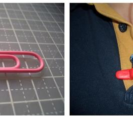Paper clip and paper clip covered in Sugur being used as an earphone clip