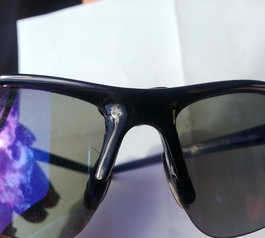 Add an eyelash-space increasing bumper to sunglasses (before)