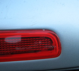 Replace the rubber seal on a brakelight (before)
