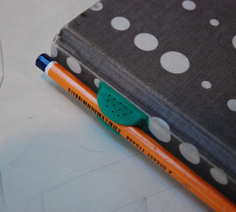 Add a pencil holder to a sketchbook