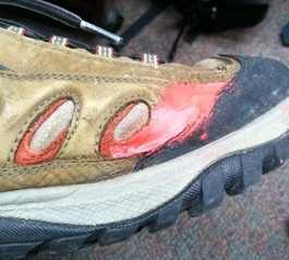 Repair a rip on hiking shoes