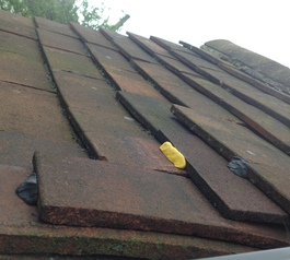 Stabilise old roof tiles