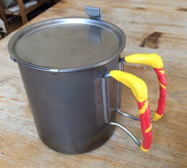 Heatproof handles on a cooking pot