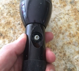 Replace the button on a flashlight