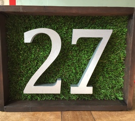 House numbers attached to fake grass using Sugru
