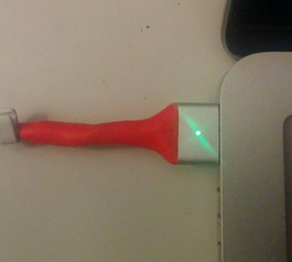 Protect your laptop's charger using a bit of red Sugru