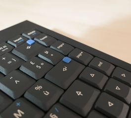 Make the smallest keyboard keys easier to find with leftover Sugru