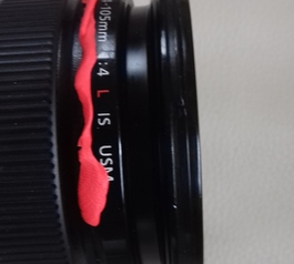 Replace the iconic red band on your Canon camera
