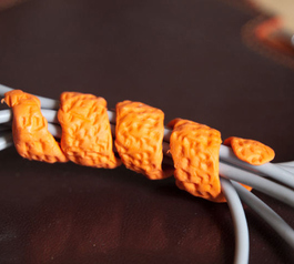 Make a springy cable-tidy