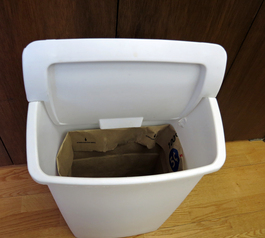 Make a waste basket lid holder
