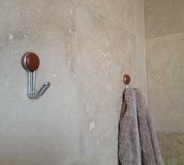 Mount towel hooks to a wall (after)