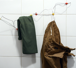 Attach hangers to the wall using Sugru (after)