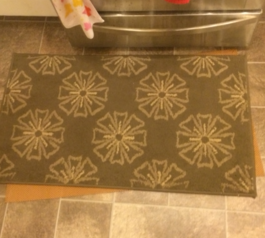 Attach a non-slip mat to your rug