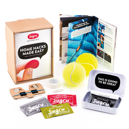 Sugru packs, boxes, tennis balls and cardboard container