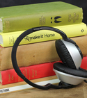 Broken headphones positioned in front of books