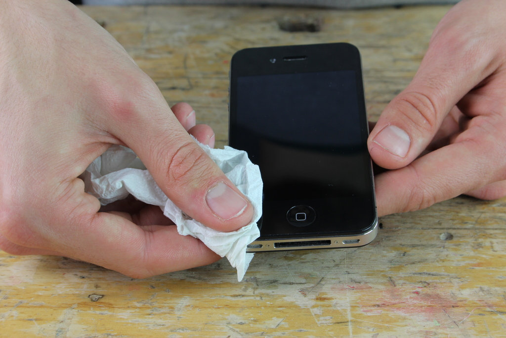 iPhone corners being cleaned with tissue