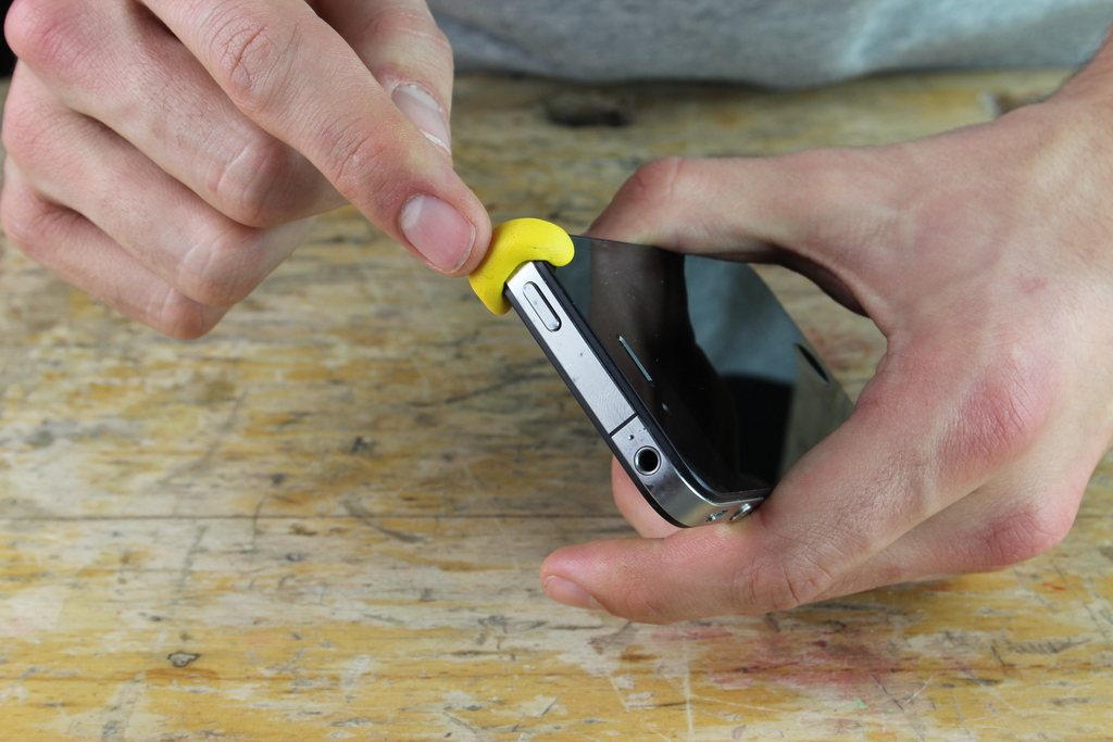 Yellow Sugru pad moulded onto phone corner