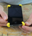 iPhone with four Sugru bumpers on corners