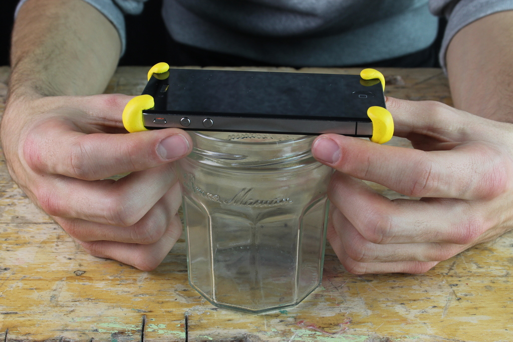 iPhone with Sugru bumpers on jar