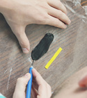 Thin strips of Sugru cut with X-acto knife