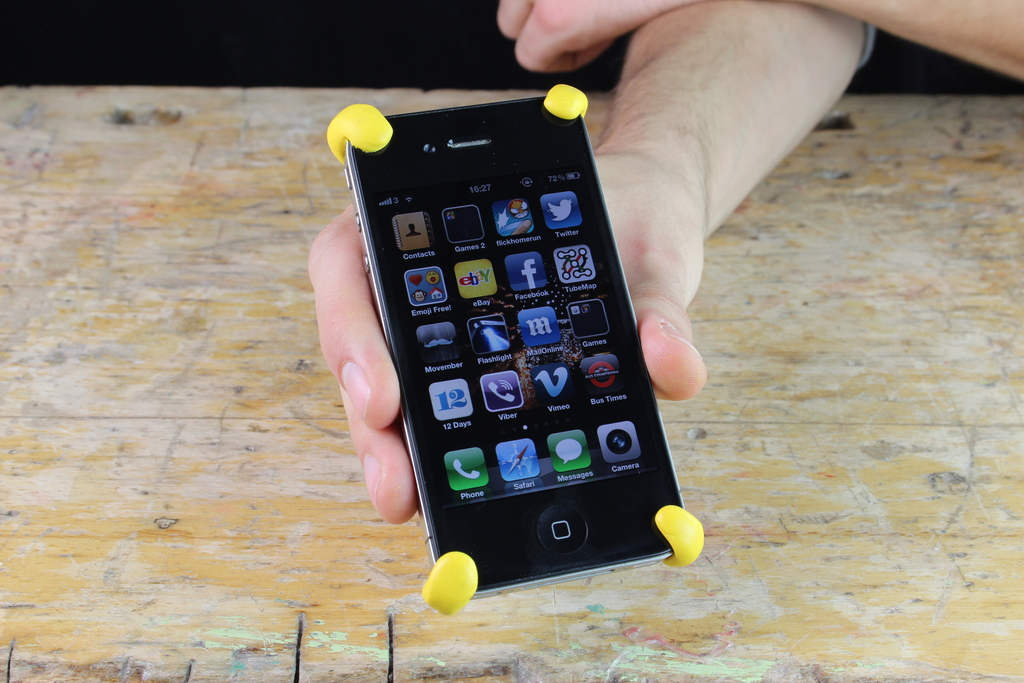 iPhone with yellow Sugru bumpers