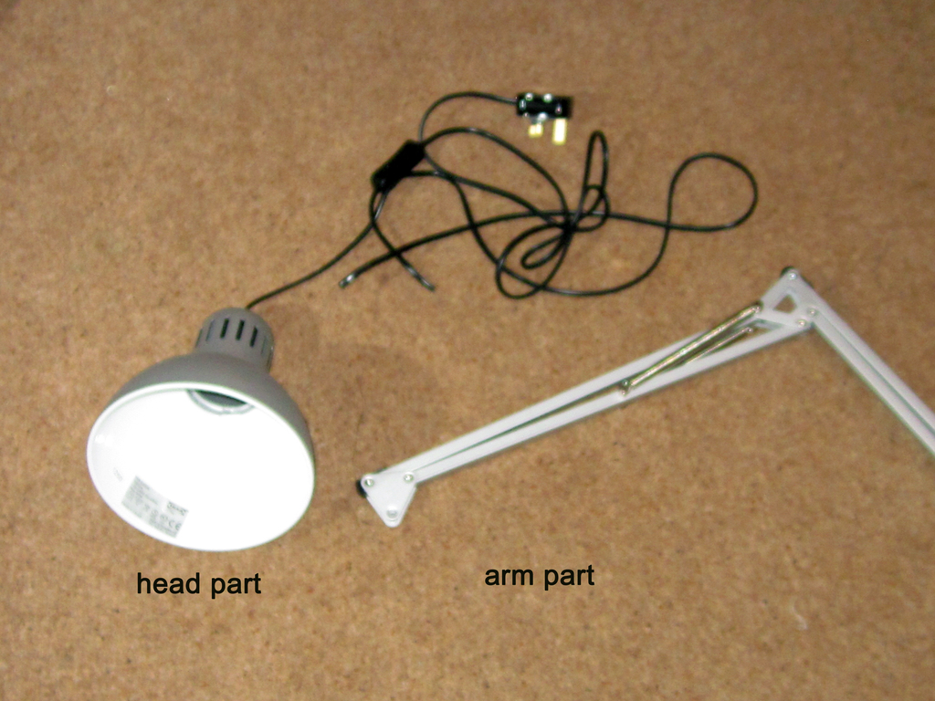 Labelled lamp parts on floor
