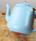 Teapot with applied Sugru being held