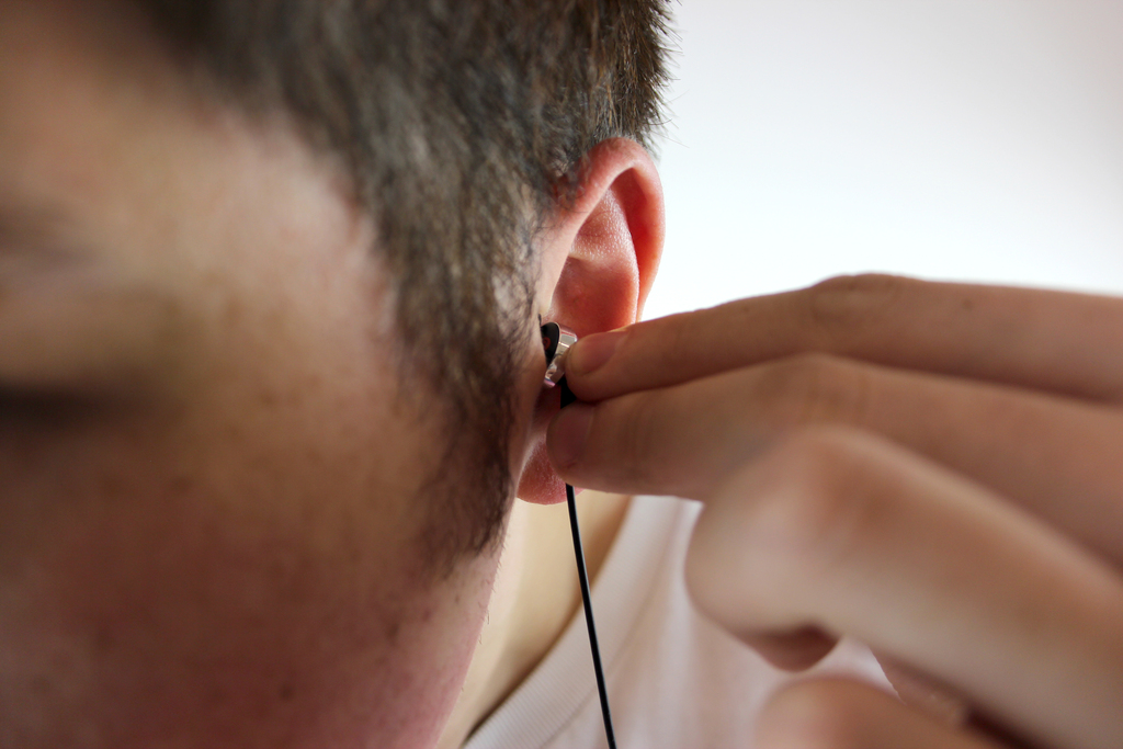 Earphone being pressed into ear