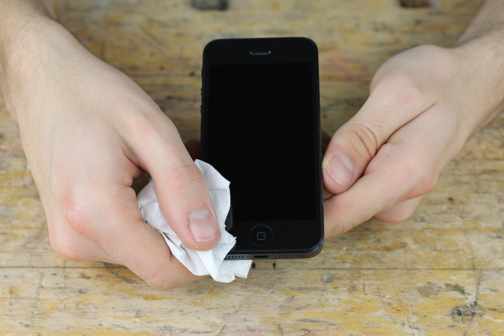 Phone edges wiped clean with tissue paper