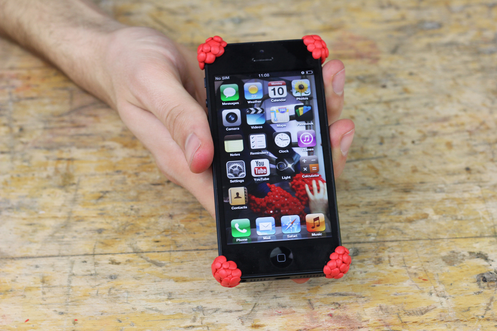 All four corners of iPhone covered with Sugru bumpers