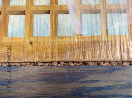 Cork chips applied to gaps in wooden panels