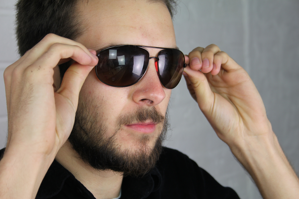 Sunglasses with Sugru pad being worn