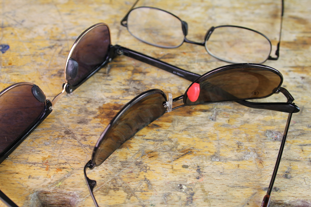 Sunglasses with red Sugru nose pad
