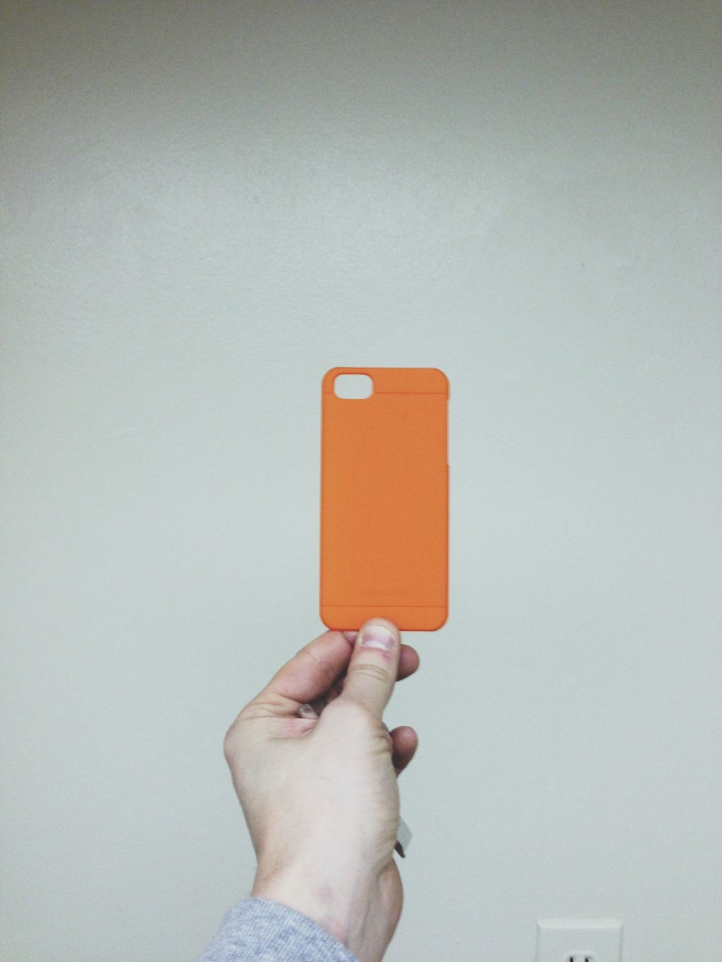 iPhone case being held