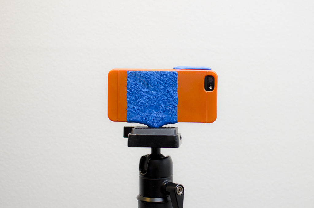 iPhone attached to camera tripod